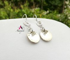 A personal favorite from my Etsy shop https://www.etsy.com/listing/233462796/sterling-silver-hammered-disc-earrings