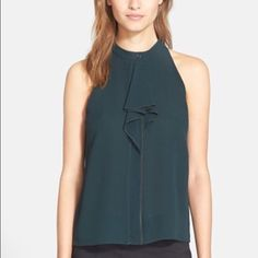 Tory Burch sleeveless green silk tank Dark green, silk, luxurious sleeveless blouse, ruffle front, buttons down the front so you can start ruffle at the very top or leave the top few open. Coordinating skirt available for bundle discount  Tory Burch Tops Tank Tops