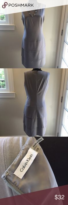 "Calvin Klein Dress. Chic. Calvin Klein Dress. Gorgeous. Between underarms 19"". Waist 32"". Hip area 40"".  Fitted top with a A line skirt. Flattering  and beautiful. Very good condition. Light gray.  Chic. Bundle with one of my jewelry sets and get 35% off‼️ Calvin Klein Dresses Midi"