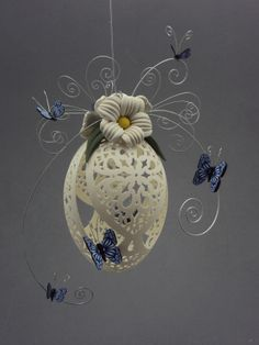 Daisies and Blue Butterflies- done with a goose egg. by Laura J Schiller