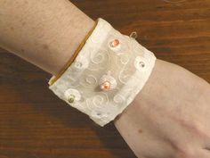 Use conductive thread and LEDs to make a lighted cuff.