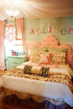 adorable pink headboard. and the ruffle bedding is gorgeous too!