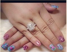 Blue with pink florals nail art.  By Bling Your Nails spa in Castro Valley, CA