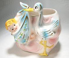 Vintage Planter Baby with Stork Delivering Newborn Pink Blue Ceramic. $9.00, via Etsy.