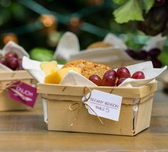 """Nice touch!  Can put anything in basket... (unfortunately, site has no ordering info for DIY...) """"A Little Bit Rustic For the casual outdoor wedding, these delightful fruit and cheese baskets make a perfect place card and appetizer all in one. Fill the baskets with some of your favorite goodies and print out hanging tags with each name and table number. Add some twine for a charming finishing touch."""""""