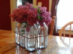 Fresh Lilacs from my lilac bush placed in old milk bottles make a perfect accent to any table