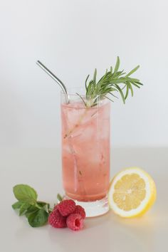 The Lemon Paradise Cocktail is made with coconut water, rum, raspberries and lemon. It's light, delicious, and super refreshing!