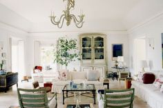 Muted colors, painted furniture, skirted slipcovers, and a Diego Giacometti cocktail table furnish the tray-ceilinged living room in Bunny Mellon's villa at Antigua's Mill Reef Club