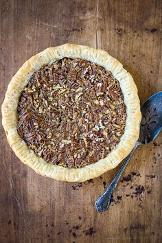 Old-Fashioned Pecan Pie | A recipe for old-fashioned pecan pie made without corn syrup. Instead, maple syrup and molasses make for a more traditional filling.