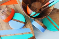 You know we're all about adding color to just about every aspect of our lives, and our kitchen tables are no exception. We've been seeing color blocked and neon tableware all over the place, especially combined with the rustic warmth of wooden bowls and trays. Naturally, we couldn't resist coming up with a DIY hack of our own. Here's a super easy way to create your own chic tableware in a matter of minutes!