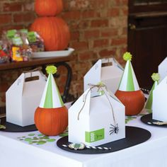 Boo! It's a Birthday | tablescape Pumpkin party hats!