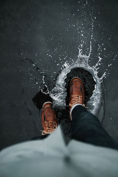 Anonymous man walking in leather boots through a puddle outdoors by Nick Bondare. - Anonymous man walking in leather boots through a puddle outdoors by Nick Bondarev – Stocksy Unite - Rain Photography, Creative Photography, Portrait Photography, Rainy Day Photography, Hipster Photography, Water Puddle, Artsy Photos, Rainy Weather, Rainy Mood