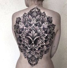 Beautiful Mandala Back Tattoo with raised effect.