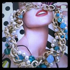 Statement Blue Beads, Pearls and Diamonds Necklace Beautiful statement necklace has gorgeous blue accent beads that run through out. Intertwined gold tone chains with pearls and diamonds. Measures 16 inches and has. 3 in extender. Jewelry Necklaces