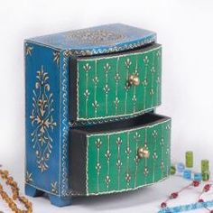 @Overstock - This hand-painted wooden jewelry box has two drawers for storage. Brightly painted in blue and green colors by the artisans from Jodhpur, Rajasthan, this jewelry box also functions nicely on a bedside table for nighttime essentials.  http://www.overstock.com/Worldstock-Fair-Trade/Wooden-Hand-painted-Green-and-Blue-2-drawer-Jewelry-Box-India/6115350/product.html?CID=214117 $36.44
