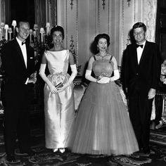 President and Mrs John F. Kennedy welcome Queen Elizabeth II and Prince Philip to the White House.