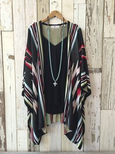 Black poncho style sweater with turquoise, red, green, and tan accents in a southwest design.   One button in the front for slight closure.   One size fits all