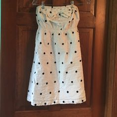 Urban Outfitters brand strapless polka dot dress. Black and white Kimchi Blue polka dot dress with bow and button detail on top. Strapless, stretchy and comfortable. Kimchi Blue Dresses Strapless
