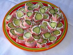Pickle wraps!! One of my favorite party treats!!! (Or just for snacking on!!) lay ham or turkey flat, spread a layer of cream cheese, roll a dill pickle up in the ham or turkey, and slice!!! (better if cold)-  These are GOOD!