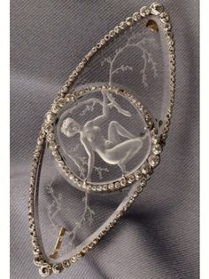 Lalique Glass Intaglio & Diamond Brooch, reverse engraved to depict a young woman among scrolling boughs, set w/old mine & rose-cut diamond accents, platinum mount skinnerinc.com