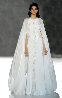 Dramatically different in this elegant caped wedding gown by Isabel Zapardiez
