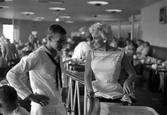 Marilyn Monroe chats with a lucky sailor, 1953
