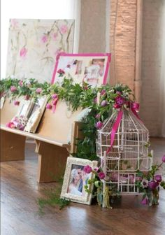 Beautiful bird cages can be used to provide a unique centerpiece or aisle decor. All flowers and garland by @cecedesignsllc