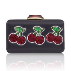 The Espey Cherry Jackpot is a rectangular box clutch wrapped with printed satin. With a cut glass clasp, KOTUR's signature brocade lining and featuring a drop-in shoulder chain, this medium-sized minaudiere fits two smartphones plus evening essentials.