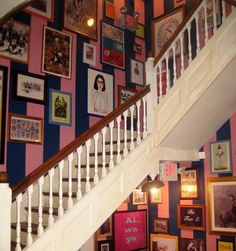 Love the picture arrangement -- not so much the striped walls and the stair railings