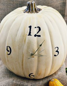 How clever is this?!!! Pumpkin with working clock and stenciled numbers from atthepicketfence.com
