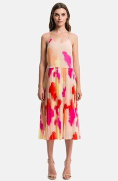 Free shipping and returns on 1.State Pleated Overlay Dress at Nordstrom.com. Splashes of vibrant color brighten up a sand-hued dress featuring a strappy racerback camisole overlaying a crisply pleated midi skirt.