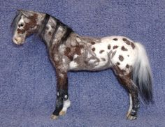 Needlefelted appaloosa by Ikarnillart. '' She stands about seven inches high at the ears, breyer classic for those familiar with that brand. Her name is Leah.  She took a long while to make. The armature was good solid wire, with the needlefelting round the outside, hooves are made of milliput. All the markings are felted on apart from her hooves and her eyes.' Description by the artist.