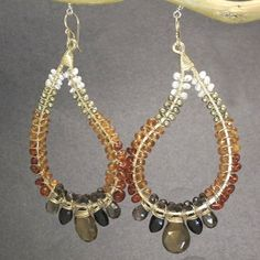 Hammered drop hoops wrapped with pearls, smoky quartz, whiskey quartz, citrine, mandarin garnet, and black spinel, about 2.   Available in 14k