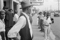 Applicants waiting for jobs in front of Federal Emergency Relief Administration offices, New Orleans, Louisiana, October 1935. Location seems to be S. Claiborne Avenue between Washington Avenue and 4th Street. Photo by Ben Shahn.