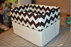 How to turn a cardboard box into a cute fabric covered basket