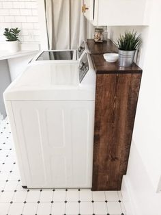 cover ugly laundry room wires with stained wood frame