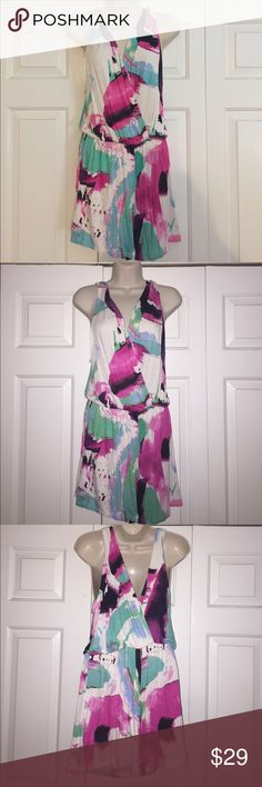 Multi colored romper Multicolored Boutique romper with plunging front and back. Elastic waist band. Very generous amount of stretch. Only worn to try on, I can't pull off rompers! Everly Tops
