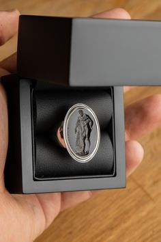 This signet ring depicts Hercules engraved onto black onyx gemstone. The intaglio is set in a sterling silver ring. The piece is carved by our master engraver, Chavdar Chushev. Signet Ring, Hercules, Black Onyx, Seals, Bellisima, Sterling Silver Rings, Rings For Men, Carving, Gemstones