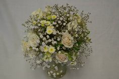 Rustic barn wedding bridal bouquet with roses and baby's breath (gypsophila). Fleurish Floral Designs