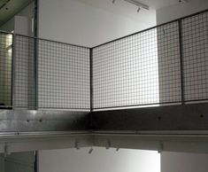 Stainless steel architectural mesh balustrade- a great application for balustrades as allows plenty of light