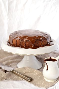 Dark chocolate, pear & hazelnut cake with juicy pear, crunchy hazelnuts, indulgent dark chocolate chunks & a hint of cinnamon, smothered in chocolate ganache. Dark Chocolate Recipes, Lindt Chocolate, Chocolate Flavors, Hazelnut Cake, Cinnamon Cake, Snack Recipes, Snacks, Sweets, Tarts