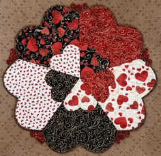 """~31"""" diameter. Pattern with paper templates for five pieced hearts with a little appliqué, yoyo's and bias binding. Love comes all together to make this sweet topper. *This is not a finished product"""