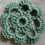 links you to a bunch of different crochet flower tutorials