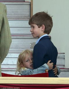 Sweet: Isla could be seen hugging her cousin tightly as the smartly-attired James smiled h...