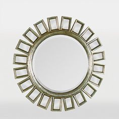 This contemporary circular mirror with an antiqued gold finish and black accents is adorned with 20 small beveled mirrors. The mirror is a terrific center piece for above a foyer or in a dining room. Mirror Bed, Round Wall Mirror, Beveled Mirror, Floor Mirror, Round Mirrors, Modern Mirrors, Rest, Circular Mirror, Sunburst Mirror
