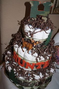 diaper cake idea for camo baby shower....need real tree camo or mossy oak camo instead of that camo