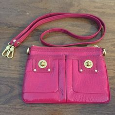 """Marc by Marc Jacobs Turnlock Percy Bag in Magenta Marc by Marc Jacobs Totally Turnlock Percy Bag. Patent leather crossbody bag in a deep magenta (not quite as bright as the photos) with logo turnlock closures at the patch front pockets. Gold-tone hardware. Detachable shoulder strap so it can be converted into a clutch. Logo-lined interior with a patch pocket. Excellent condition - no signs of wear (worn only a few times). Dimensions are 6.5"""" x 9.5"""" with a 24"""" strap drop. Marc by Marc Jacobs…"""