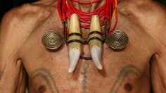 The dying art of headhunter tattoos - ancient tradition of body art