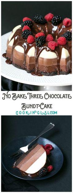 Three chocolate bundt cake no bake topped with  raspberries, blackberries and smmmmooootthh chocolate sauce. mmm...