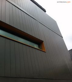 Black cladding with wood lining framing the window Black Cladding, Steel Cladding, House Cladding, Facade House, Metal Facade, Metal Siding, Metal Panels, Exterior Siding, Exterior Design